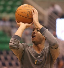 Paul Fraughton | The Salt Lake Tribune. Utah's Devin Harris warms up before the  Minnesota game.  Thursday, March 15, 2012