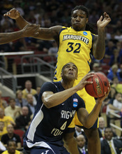 BYU forward Brandon Davies (0) is defended by Marquette forward Jae Crowder (32) in the first half of their NCAA tournament second-round college basketball game in Louisville, Ky., Thursday, March 15, 2012. (AP Photo/John Bazemore)