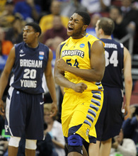Marquette forward Davante Gardner (54) reacts after scoring in the first half of their NCAA tournament second-round college basketball game against BYU in Louisville, Ky., Thursday, March 15, 2012. At rear is BYU guard Anson Winder (20) and forward Noah Hartsock (34). (AP Photo/John Bazemore)