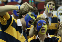 Members of the Marquette pep band react in the first half of their NCAA tournament second-round college basketball game against BYU in Louisville, Ky., Thursday, March 15, 2012. (AP Photo/John Bazemore)