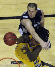 Brigham Young forward Noah Hartsock (34) fouls Marquette forward Jae Crowder (32) in the second half of their NCAA tournament second-round college basketball game in Louisville, Ky., Thursday, March 15, 2012. Marquette beat BYU 88-68. (AP Photo/Dave Martin)