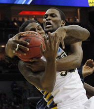 Marquette forward Jae Crowder, front, battles Murray State forward Ivan Aska (42) for a rebound in the first half of their NCAA third-round tournament college basketball game in Louisville, Ky., Saturday, March 17, 2012. (AP Photo/Dave Martin)