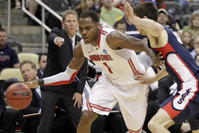 Ohio State's Deshaun Thomas (1) dribbles around Gonzaga's Michael Hart during the first half of an NCAA tournament third-round college basketball game in Pittsburgh, Saturday, March 17, 2012. ( AP Photo/Gene J. Puskar)