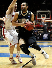 Vanderbilt forward Jeffery Taylor, right, drives past Wisconsin guard Jordan Smith during the first half of an NCAA tournament third-round college basketball game on Saturday, March 17, 2012, in Albuquerque, N.M. (AP Photo/Matt York)