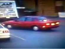 Courtesy of Salt Lake City Police Department  Police believe the shooting suspect left C.J. Smoke Shop in this red sedan, following an initial physical altercation with store employee Stephen Guadalupe Chavez on Wednesday. The suspect later returned in another car and shot and killed Chavez, according to police.