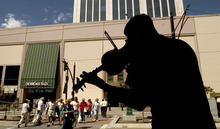 Al Hartmann  |  Tribune file photo Street musician Chris Jacoby plays his violin to the noon crowds walking between Crossroads and ZCMI Malls on Main Street in Salt Lake i 2004.