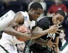 South Florida forward Victor Rudd Jr., left, competes with Ohio forward Jon Smith for the ball in the first half of a third-round NCAA men's college basketball tournament game Sunday, March 18, 2012, in Nashville, Tenn. (AP Photo/Mark Humphrey)