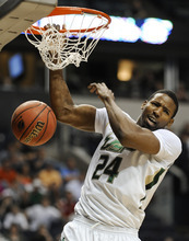South Florida forward Augustus Gilchrist dunks tgainst Ohio in the first half of a third-round NCAA college basketball tournament game Sunday, March 18, 2012, in Nashville, Tenn. (AP Photo/Donn Jones)