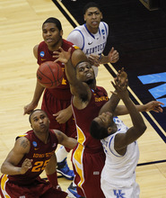 Iowa State forward Melvin Ejim, center, fights for a rebound with Kentucky forward Michael Kidd-Gilchrist, bottom right, Kentucky forward Anthony Davis (23), Iowa State center Percy Gibson, top left, and Iowa State guard Tyrus McGee (25) in the second half of their NCAA third-round tournament college basketball game in Louisville, Ky., Saturday, March 17, 2012. Kentucky beat Iowa State 87-71. (AP Photo/Dave Martin)