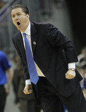 Kentucky head coach John Calipari reacts in the second half of their NCAA third-round tournament college basketball game against Iowa State in Louisville, Ky., Saturday, March 17, 2012. Kentucky beat Iowa State 87-71. (AP Photo/Dave Martin)