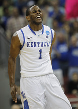 Kentucky guard Darius Miller (1) reacts in the second half of their NCAA third-round tournament college basketball game against Iowa State in Louisville, Ky., Saturday, March 17, 2012. Kentucky won 87-71.  (AP Photo/Dave Martin)