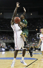 Norfolk State's Quasim Pugh, right, collides with Florida's Patric Young, in the first half of their NCAA tournament third-round college basketball game in Omaha, Neb., Sunday, March 18, 2012. (AP Photo/Nati Harnik)