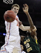Norfolk State's Kyle O'Quinn (10) and Florida's Erik Murphy compete for a rebound in the first half of their NCAA tournament third-round college basketball game in Omaha, Neb., Sunday, March 18, 2012. (AP Photo/Nati Harnik)