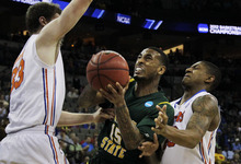 Norfolk State guard Rodney McCauley (15) struggles between Florida defenders Bradley Beal and Erik Murphy (33) during the first half of a third round NCAA college basketball tournament game at CenturyLink Center in Omaha, Neb., Sunday, March 18, 2012. (AP Photo/Nati Harnik)