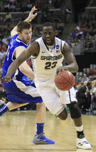 Michigan State's Draymond Green (23) drives past Saint Louis' Brian Conklin (14) during the first half of an NCAA men's college basketball tournament third-round game in Columbus, Ohio, Sunday, March 18, 2012. (AP Photo/Tony Dejak)