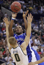 Saint Louis' Jordair Jett, top, shoots over Michigan State's Russell Byrd during the first half of an NCAA college basketball tournament third-round game Sunday, March 18, 2012, in Columbus, Ohio. (AP Photo/Jay LaPrete)