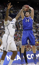 Saint Louis' Brian Conklin (14) shoots over Michigan State's Derrick Nix (25) during the first half of an NCAA men's college basketball tournament third-round game in Columbus, Ohio, Sunday, March 18, 2012. (AP Photo/Jay LaPrete)
