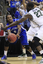 Saint Louis' Jordair Jett (5) passes the ball past Michigan State's Draymond Green (23) during the first half of an NCAA men's college basketball tournament third-round game in Columbus, Ohio, Sunday, March 18, 2012. (AP Photo/Tony Dejak)