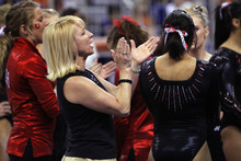 Brad McClenny  |  The Gainsville Sun Utah's co-head coach Megan Marsden cheers her team as they compete on the beam during an NCAA college gymnastics meet against Florida, Friday, March 16, 2012, in Gainesville, Fla. Florida won the meet. (AP Photo/The Gainesville Sun, Brad McClenny)  THE INDEPENDENT FLORIDA ALLIGATOR OUT; MAGS OUT