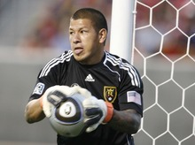 Trent Nelson  |  The Salt Lake Tribune Real goalkeeper Nick Rimando pulls in the ball. Real Salt Lake vs. Columbus Crew, MLS soccer at Rio Tintio Stadium in Sandy, Saturday, August 14, 2010.