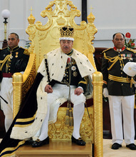 King of Tonga George Tupou V sits on his throne in Nuku'aloka, Tonga, in August 2008. The king, who championed a more democratic system of government in the Pacific island nation, died Sunday March 18, 2012, at a Hong Kong hospital. (AP Photo/New Zealand Herald)