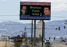 FILE - In this March 10, 2012 file photo, an electronic billboard is displayed over a sports memorabilia store in north Denver. The Denver Broncos seem to be headed for another meeting with Peyton Manning. (AP Photo/David Zalubowski, File)