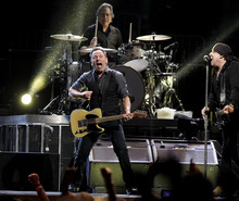Bruce Springsteen, left, performs with Steve Van Zandt, right, Max Weinberg, rear, and the E Street Band during Springsteen's