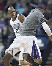 Sacramento Kings' Travis Outlaw, left, and DeMarcus Cousins celebrate Outlaw's dunk against the Minnesota Timberwolves during the second half of an NBA basketball game in Sacramento, Calif., Sunday, March 18, 2012. The Kings won 115-99. (AP Photo/Steve Yeater)