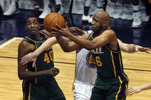 Scott Sommerdorf  |  The Salt Lake Tribune              Jamaal Tinsley of the Jazz drives with the ball as team mate Jeremy Evans watches at left during first half play. The Utah Jazz trailed the Golden State Warriors 51-46 at the half at Energy Solutions Arena, Saturday, March 17, 2012.