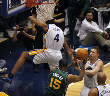 Scott Sommerdorf  |  The Salt Lake Tribune              Utah center Derrick Favors came away holding his left shoulder after  this play where Golden State's Brandon Rush came down on him in this battle to block Favors' shot during first half play. The Utah Jazz trailed the Golden State Warriors 51-46 at the half at Energy Solutions Arena, Saturday, March 17, 2012.