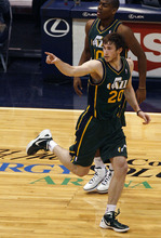 Scott Sommerdorf  |  The Salt Lake Tribune              Gordon Hayward points back at team mate Paul Millsap after Millsap's assist on his jump shot during first half play. The Utah Jazz trailed the Golden State Warriors 51-46 at the half at Energy Solutions Arena, Saturday, March 17, 2012.