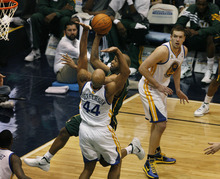 Scott Sommerdorf  |  The Salt Lake Tribune              Jazz guard Jamaal Tinsley drives to the basket past the Warrior's Richard Jefferson during first half play.The Utah Jazz trailed the Golden State Warriors 51-46 at the half at Energy Solutions Arena, Saturday, March 17, 2012.