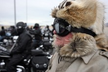 Kim Raff     The Salt Lake Tribune Terry Tuke gets on his motorcyle Sunday at Miller Motorsports Park in Grantsville to make the final leg of the 35th annual Polar Bear Ride to celebrate the 70th anniversary of the Salt Lake Motorcycle Club.