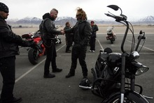 Kim Raff     The Salt Lake Tribune Riders make a pit stop Sunday at the Miller Motorsports Park in Grantsville during the 35th annual Polar Bear Ride to celebrate the 70th anniversary of the Salt Lake Motorcycle Club.