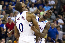 Kansas forward Thomas Robinson (0) and Tyshawn Taylor celebrate their 63-60 win over Purdue in a third-round NCAA tournament college basketball game at the CenturyLink Center, Sunday, March 18, 2012, in Omaha, Neb. (AP Photo/The Lincoln Journal-Star, Ted Kirk)