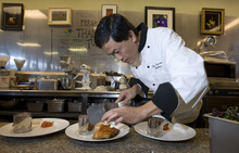 Al Hartmann   |  The Salt Lake Tribune  Hai Fitzgerald, chef and owner of Thyme and Seasons restaurant in Bountiful, prepares meals at the restaurant.