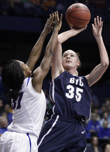 BYU forward Kristen Riley (35) shoots over DePaul forward Jasmine Penny (31) during the first half of an NCAA tournament first-round women's college basketball game in Rosemont, Ill., Saturday, March 17, 2012. (AP Photo/Nam Y. Huh)