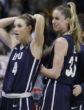 BYU guard Kim Parker (4) and forward Kristen Riley (35) react to their team's loss to DePaul in an NCAA tournament first-round women's college basketball game in Rosemont, Ill., Saturday, March 17, 2012. DePaul won 59-55. (AP Photo/Nam Y. Huh)
