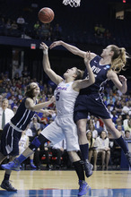 DePaul guard Anna Martin (5) shoots against BYU guard Kim Parker (4) and forward Kristen Riley (35) during the second half of an NCAA tournament first-round women's college basketball game in Rosemont, Ill., Saturday, March 17, 2012. DePaul won 59-55. (AP Photo/Nam Y. Huh)