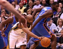 Leah Hogsten  |  The Salt Lake Tribune The Jazz's Jamaal Tinsley catches his through-the-legs pass on the Thunder's Nazr Mohammed. Utah Jazz defeated Oklahoma City Thunder 97-90 Tuesday, March 20, 2012, at the Energy Solutions Arena in Salt Lake City, Utah .