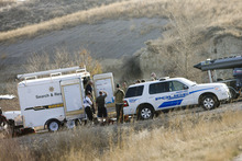 Kim Raff | The Salt Lake Tribune  Police investigate a body found in the Jordan River off of the Jordan River Parkway on 12300 south in Draper, Utah on March 11, 2012.