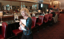 Francisco Kjolseth  |  The Salt Lake Tribune Hostess Holly Carleston greets customers at Lamb's Grill, which has retained its classic counter.