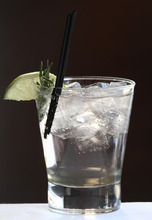 Rick Egan  | The Salt Lake Tribune  Zy's Sapphire Rose cocktail is made with Bombay Sapphire Gin, rosemary-infused simple syrup, soda water, a rosemary sprig and lime slice for garnish.