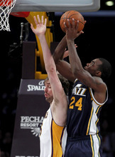 Utah Jazz forward Paul Millsap (24) shoots over Los Angeles Lakers forward Pau Gasol, left, of Spain, during the first half of an NBA basketball game in Los Angeles, Sunday, March 18, 2012. (AP Photo/Alex Gallardo)