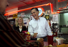 Republican presidential candidate, former Massachusetts Gov. Mitt Romney, and his wife Ann, greet people during a campaign stop at Charlie Parker's Diner, in Springfield, Ill., Monday, March 19, 2012. (AP Photo/Steven Senne)
