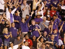 Trent Nelson  |  The Salt Lake Tribune  University of Washington football fans celebrate another Huskies touchdown during an Oct. 1 victory over Utah's Utes at Rice-Eccles Stadium. Utah's tourism industry scored its own touchdown as a result of Utah's Pac 12 membership, according to a new study. More than 1,900 Huskie fans traveled to Salt Lake City for that game, more than triple the number of visitors at Utah home games in previous football seasons.