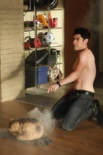 Schmidt (Max Greenfield) burns the Thanksgiving turkey in an episode of