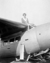 In this undated photo, Amelia Earhart, the first woman to cross the Atlantic Ocean by plane sits on top of a plane. Secretary of State Hillary Rodham Clinton is wading into one of the 20th century's most enduring mysteries: the fate of American aviator Amelia Earhart, disappeared over the South Pacific 75 years ago. Clinton is meeting March 20, 2012, with historians and scientists from The International Group for Historic Aircraft Recovery, which will launch a new search in June for the wreckage of Earhart's plane off the remote island of Nikumaroro. (AP Photo)