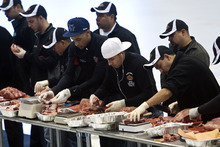 Chris Detrick  |  The Salt Lake Tribune Meat cutters compete in the semi-final round of the Texas Roadhouse meat-cutting challenge at the Utah Olympic Oval Wednesday March 21, 2012. The meat cutters were judged on the quality, yield and speed of the steaks they cut from forty pounds of beef, consisting of two sirloins, one filet and one ribeye. Eight finalists will advance to the final round, competing for a grand prize of $20,000 and the