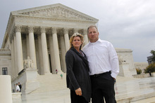 FILE - In this Oct. 14, 2011 file photo, Mike and Chantell Sackett of Priest Lake, Idaho, pose for a photo in front of the Supreme Court in Washington. The Supreme Court ruled unanimously Wednesday that property owners have a right to prompt review by a judge of an important tool used by the Environmental Protection Agency to address water pollution. The court sided with an Idaho couple who object to an EPA order that blocked construction of their new home near a scenic lake and threatened fines of more than $30,000 a day. (AP Photo/Haraz N. Ghanbari, File)